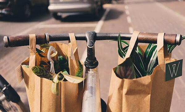 Paper shopping bags on a bicycle handlebars